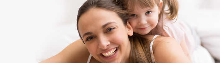 daughter-young-girl-mom-laying-smiling-123rF-23402276_xxl.png